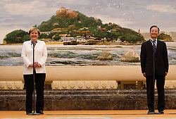epa02250020 German Chancellor Angela Merkel (L) and Chinese Premier Wen Jiabao address members of a German-Chinese dialogue forum in the Great Hall of the People in Beijing, China on 16 July 2010. The German Chancellor is in China for an official visit from 15-18 July 2010.  EPA/HOW HWEE YOUNG / POOL