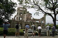 Tourists visit the Atomic Dome Memorial in Hiroshima, Japan, on Thursday June 30st 2005. The Dome is a memorial to the atomic bombing of the city of Hiroshima, on 6th AUgust 1945, during World War 2. The bomb was the first atomic bomb to be used in warfare, and was dropped by the US military.