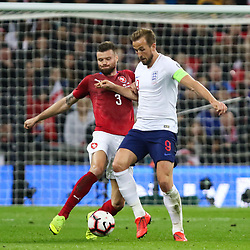 Harry Kane  of England and Ondrej Celustka of Czech Republic challenge for the ball