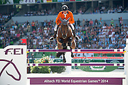 Jeroen Dubbeldam - Orient Express HDC<br /> Alltech FEI World Equestrian Games™ 2014 - Normandy, France.<br /> © DigiShots - Jon Stroud