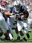 Sept 19, 2009; State College, PA, USA; Temple linebacker John Haley (46) gets a hand on Penn State running back Evan Royster (22) during the first half at Beaver Stadium.  Mandatory Credit: Jason Miller-US PRESSWIRE