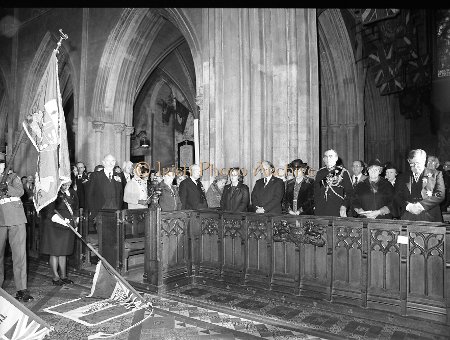 Remembrance Day Service.1983.13.11.1983.11.13.1983.13th November 1983..A remembrance service was held in St Patrick's Cathederal, Dublin,(Poppy Day) to commerate the Irish Fallen who died  whilst on service with the British Army in the two World Wars..Photo of an upstanding congregation as the colours,An Irish Army flag and the flags of the Royal British Legion,are trooped to the altar.