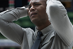 Stressed businessman at stock exchange (Credit Image: © Image Source/Jose Pelaez/Image Source/ZUMAPRESS.com)