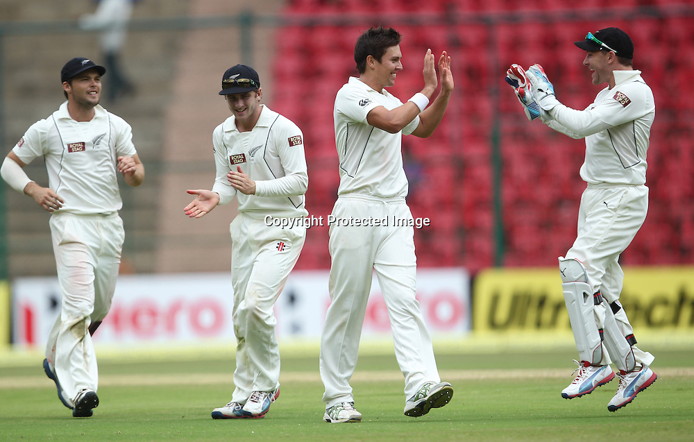 New Zealand cricket tour to India. September 2012 Bengaluru :  NewZealand's Trent Boult with team mates celebrate the wicket of India's Gautam Gambhir during the 4th day of the test match in Bengaluru on Monday.  Photo: Photosport.co.nz