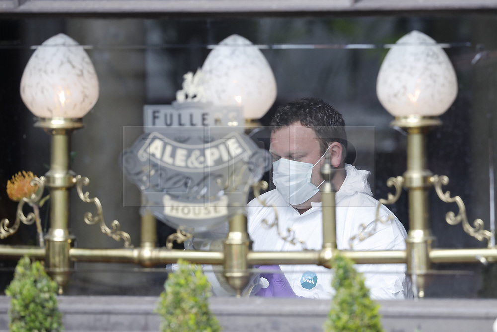 © Licensed to London News Pictures. 05/06/2017. London, UK.  Police forensic officers search inside The Barrow Boy and Banker pub on London Bridge  following a terrorist attack in Saturday evening. Three men attacked members of the public  after a white van rammed pedestrians on London Bridge.   Ten people including the three suspected attackers were killed and 48 injured in the attack. Photo credit: Peter Macdiarmid/LNP