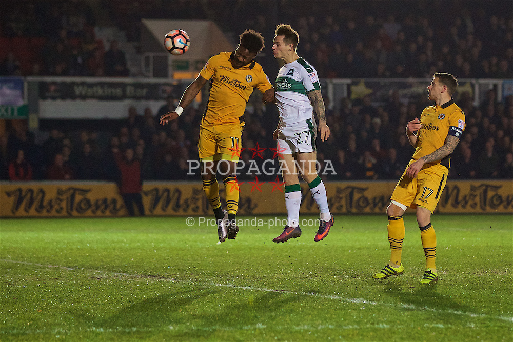 NEWPORT, WALES - Wednesday, December 21, 2016: Newport County's Jennison Myrie-Williams and Plymouth Argyle's Craig Tanner during the FA Cup 2nd Round Replay match at Rodney Parade. (Pic by David Rawcliffe/Propaganda)