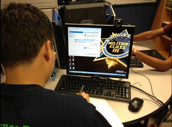 Students at Eastwood Academy prepare for the CyberPatriot National Youth Cyber Defense Competition.