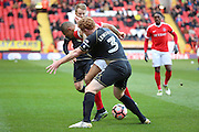 Milton Keynes Dons defender Dean Lewington (3) battles for possesion with Charlton Athletic striker Josh Magennis (9) and gets shirt pulled during the The FA Cup match between Charlton Athletic and Milton Keynes Dons at The Valley, London, England on 3 December 2016. Photo by Matthew Redman.