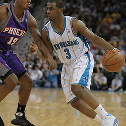 03 December 2008: New Orleans Hornets guard Chris Paul (3) is defended by Phoenix Suns guard Raja Bell (19) during a 104-91 victory by the New Orleans Hornets over the Phoenix Suns at the New Orleans Arena in New Orleans, LA..