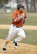 Middletown, New York - An Orange County Community College player runs to third base during a junior college baseball game on April 2, 2011.