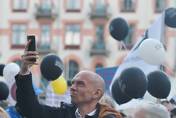 September 29, 2018 - Krakow, Poland - An activist takes a selfie during an annual 'March of Secularity' protest to demand a secular education and Poland to be a country free from the influence of the Church. .On Saturday, September 29, 2018, in Krakow, Poland. (Credit Image: © Artur Widak/NurPhoto/ZUMA Press)