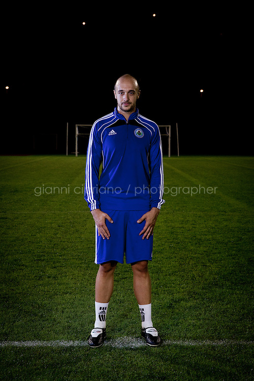 SERRAVALLE, SAN MARNO - 3 OCTOBER 2011:  Fabio Bollini , 28, poses at the Olympic Stadium before the upcoming and last Euro 2012 qualification game against Moldova on October 11, in San Marino on October 3, 2011. Fabio Bollini works at Traslocasa, the moving company he owns with his brother. The San Marino national football team is the last team in the FIFA  World Ranking (position 203). San Marino, whose population reaches 30,000 people, has never won a game since the team was founded in 1988. They have only ever won one game, beating Liechtenstein 1&ndash;0 in a friendly match on 28 April 2004. The Republic of San Marino, an enclave surronded by Italy situated on the eastern side of the Apennine Moutanins, is the oldest consitutional republic of the world<br /> <br /> <br /> ph. Gianni Cipriano