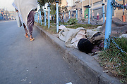 Homeless boys of Addis Ababa. Ethiopia, early morning 12-03-08...///   In Addis Ababa 85% of the population lives in slums, about 21% of people in the capital city are living on less than 1 dollar per day..Migration to urban areas is usually motivated by the hope of better living conditions. Society growth, migration, and urbanization are straining governments capacity to provide people basic services. Poverty and health conditions are getting worse. Over than 120.000 people live without house, 18% are kids, with ages between 7 and 20 years old. Severals NGOs supply the problem by various support programs. Italian organization provide by the help of young street artistes with circus therapy project.