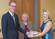 From left: Joseph Shields, Vice President for Research & Creative Activity and Dean of Ohio University's Graduate College along with Pam Benoit, Executive Vice President and Provost, congratulate Michele Fiala as one of five Presidential Research Scholars during the 2016 Faculty Awards Recognition Ceremony held at Baker Center on Tuesday, September 6, 2016.