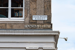 An activist group have attached alternative street signs on  streets with ties to Scotland's slave trade on Dundas Street , Edinburgh Scotland