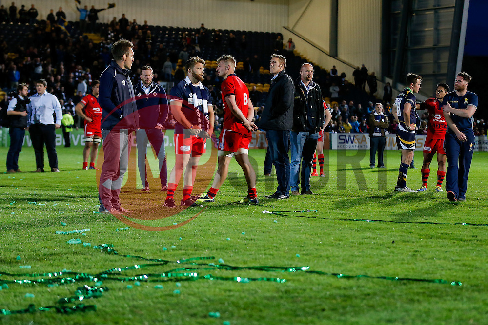Bristol Rugby players look dejected with the celebration streamers laying on the pitch after Worcester score a converted try with the last play of the game to draw the match 30-30 and win by 1 point over the two legs to deny Bristol promotion to the Aviva Premiership - Photo mandatory by-line: Rogan Thomson/JMP - 07966 386802 - 27/05/2015 - SPORT - Rugby Union - Worcester, England - Sixways Stadium - Worcester Warriors v Bristol Rugby - Greene King IPA Championship Play-Off Final 2nd Leg.