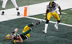 Feb 6, 2011; Arlington, TX, USA; Green Bay Packers wide receiver Jordy Nelson (left) scores a touchdown in front of Pittsburgh Steelers cornerback William Gay (22) during the first half of Super Bowl XLV at Cowboys Stadium.  Green Bay defeated Pittsburgh 31-25.