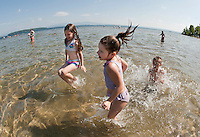 Project EXTRA headed to the beach at Ellacoya State Park and Jewel Simmons and Isabella Thibault did not waste any time jumping in the water to cool off as temperatures reached 100 degrees Friday.    (Karen Bobotas/for the Laconia Daily Sun)