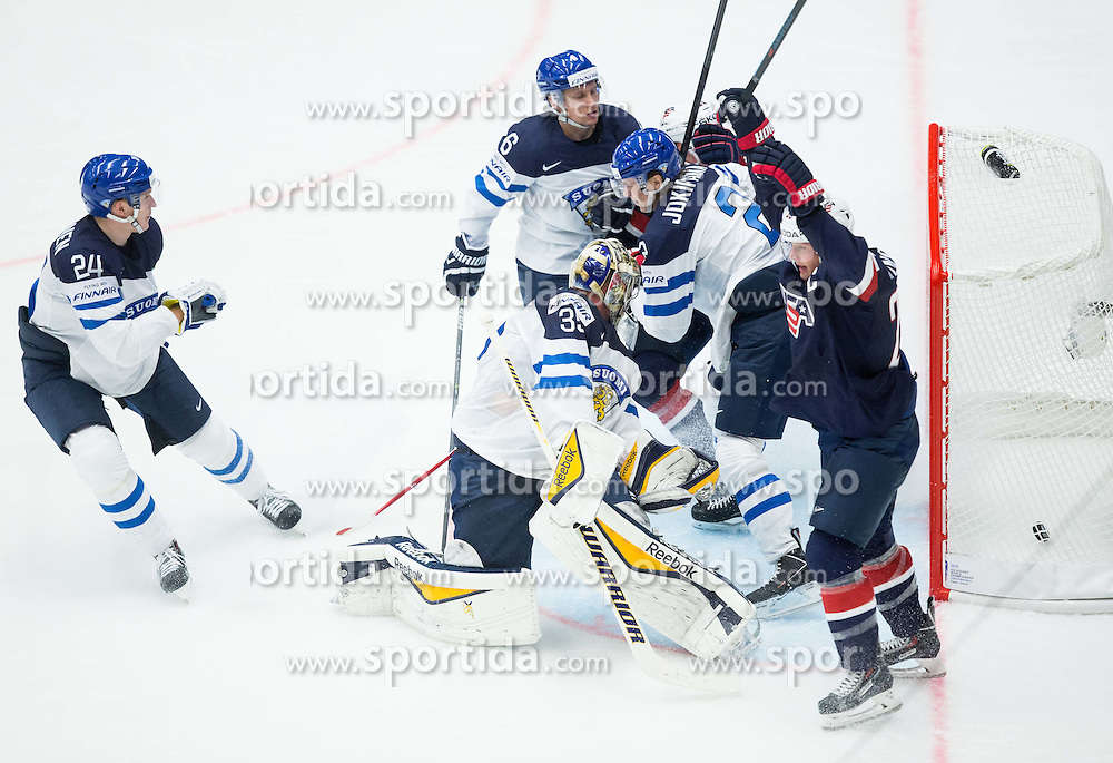 Matt Hendricks of USA celebrates after scoring second goal for USA  vs Pekka Rinne of Finland and Jyrki Jokipakka of Finland during Ice Hockey match between USA and Finland at Day 1 in Group B of 2015 IIHF World Championship, on May 1, 2015 in CEZ Arena, Ostrava, Czech Republic. Photo by Vid Ponikvar / Sportida