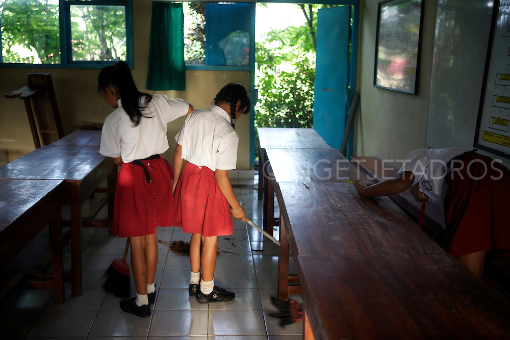 Balinese school girls cleaning up a classroom after a midterm break.<br /> The atmosphere was a delight as all students where participating without protesting!<br /> Ubud, Bali 2013