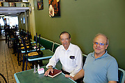 Rabbi Joseph Kaufman (left), a 39-year Miami Beach resident, sits with his friend Melvin Safra in Mr. Safra's  restaurant, Bagel Time in Miami Beach, Florida July 17, 2011. ..Kendrick Brinson/LUCEO