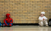 Spiderman Anthony Zirille, 3, checks out the mummy costume of Grace Branstool, 5, during the Johnstown Lions Club's Halloween contest at Adams Middle School on Oct. 28. Branstool won the award for scariest costume in the 3 to 5-year-old category.