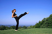 front kick - attractive young woman practicing self defense