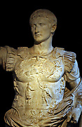 Emperor Augustus.  From Villa of Livia at Prima Porta, near Rome, C 20BC.  Augustus raises his right arm in the gesture of a general addressing his troops.  The military commander's cloak and armour were the most distinctive of all Roman power costumes.  The breastplate carries an elaborate allegory of the return of the standards lost to the Parthians in 19BC  The marble statue was once brightly painted.