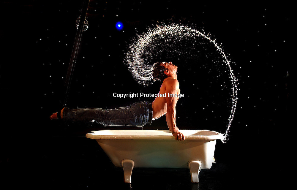 .The 'bath boy', David O'Mer, one of the performers from La Clique whose mix of circus and burlesque has established it as a Fringe favourite..=======================================.Festival 2004: La Clique -A Sideshow Burlesque, The Famous Spiegeltent..David O'Mer, a shooting star in the world of German vaudeville performs his acrobatic act over and in a bathtub..Pic.... Neil Hanna.Edinburgh Festival.2004.Arts
