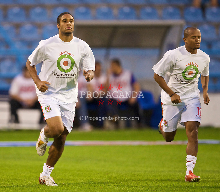 PODGORICA, MONTENEGRO - Wednesday, August 12, 2009: Wales' Ashley Williams warms-up wearing a shirt in support of former captain John Hartson who is battling against cancer, and to promote awareness of men's health issues with web site checkemlads.com, before an international friendly match against Montenegro at the Gradski Stadion. (Photo by David Rawcliffe/Propaganda)