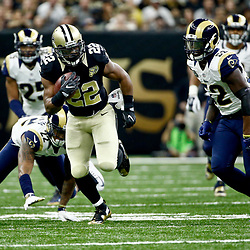 Nov 27, 2016; New Orleans, LA, USA;  New Orleans Saints running back Mark Ingram (22) runs from Los Angeles Rams offensive tackle Pace Murphy (72) and middle linebacker Alec Ogletree (52) during the first half of a game at the Mercedes-Benz Superdome. Mandatory Credit: Derick E. Hingle-USA TODAY Sports