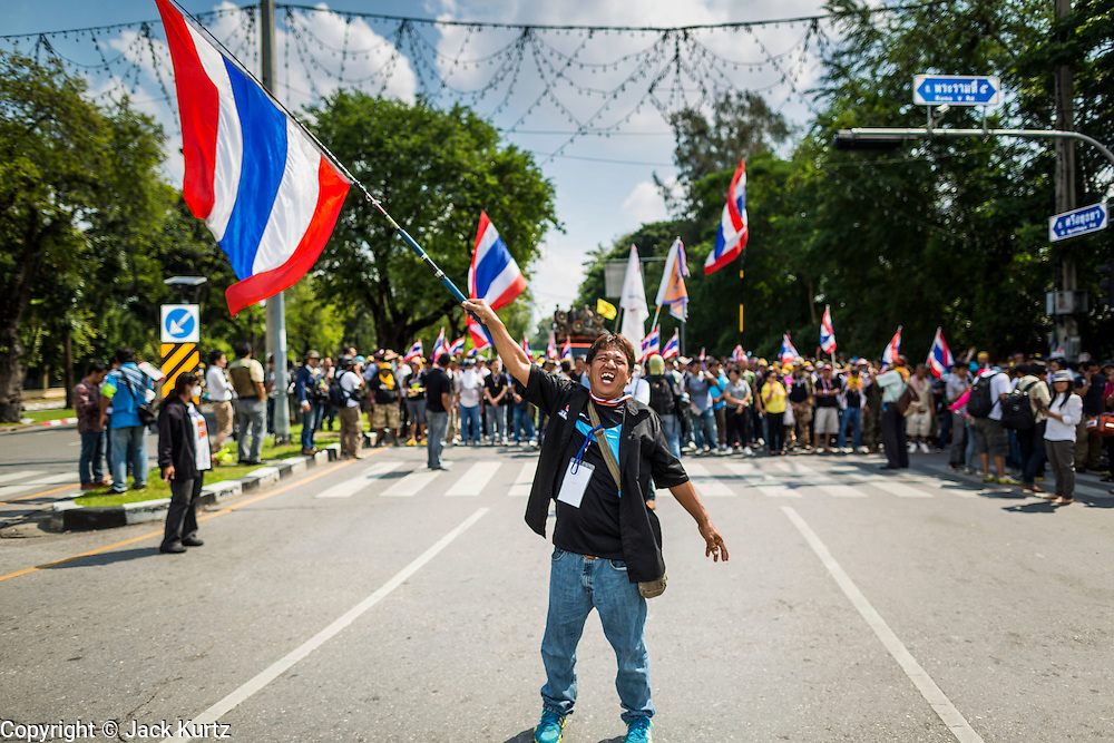 A Thai anti-government protestor waves a Thai flag and screams at riot police in Bangkok. Protestors opposed to the government of Thai Prime Minister Yingluck Shinawatra spread out through Bangkok this week. Protestors have taken over the Ministry of Finance, Ministry of Sports and Tourism, Ministry of the Interior and other smaller ministries. The protestors are demanding the Prime Minister resign, the Prime Minister said she will not step down. This is the worst political turmoil in Thailand since 2010 when 90 civilians were killed in an army crackdown against Red Shirt protestors. The Pheu Thai party, supported by the Red Shirts, won the 2011 election and now govern. The protestors demanding the Prime Minister step down are related to the Yellow Shirt protestors that closed airports in Thailand in 2008.