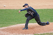 Goshen, New York - A John S. Burke Catholic High School player pitches the ball in a varsity baseball game on May 2, 2014.