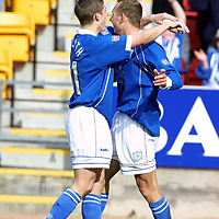 St Johnstone v Hibs    1.4.01<br />Ross Forsyth congratulates Tommy Lovenkrands on his second goal<br /><br />Pic by Graeme Hart<br />Copyright Perthshire Picture Agency<br />Tel: 01738 623350 / 07990 594431
