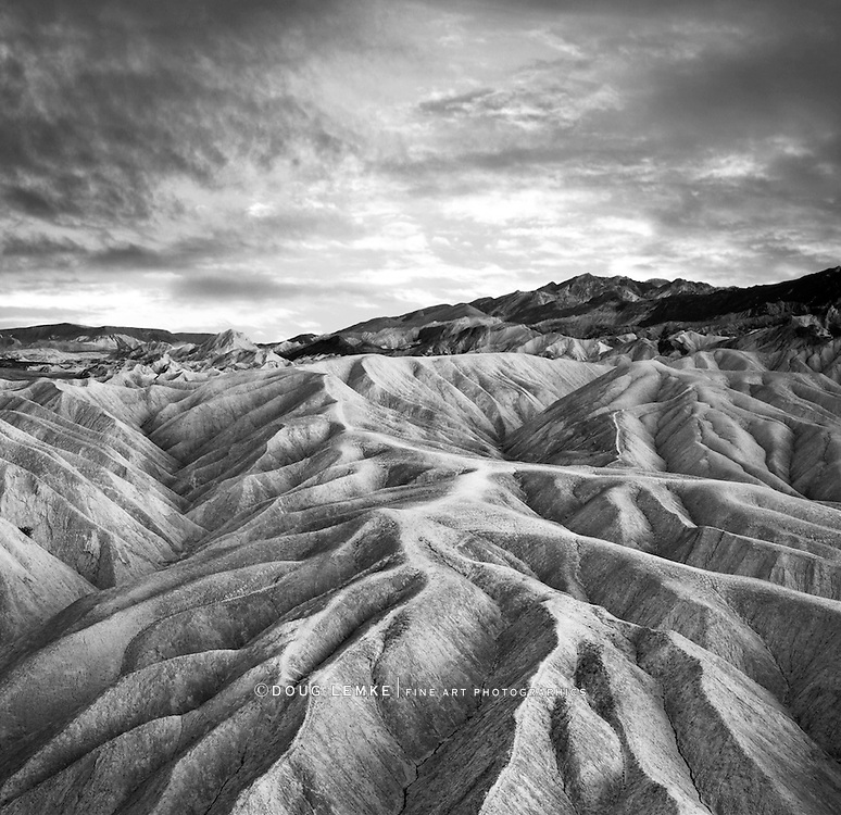 A stormy sunset over heavily eroded ridges at Zabriskie Point, Death Valley National Park, California, USA