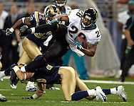 Jacksonville Jaguars running back Fred Taylor (28) is tripped up by St. Louis Rams defensive back Mike Furrey (25) after a 13-yard gain in the first quarter at the Edward Jones Dome in St. Louis, Missouri, October 30, 2005.  The Rams beat the Jaguars 24-21.