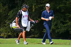 September 24, 2017 - Atlanta, Georgia, United States - Justin Rose (R) and his caddie Mark Fulcher walk off the second tee during the final round of the TOUR Championship at the East Lake Club. (Credit Image: © Debby Wong via ZUMA Wire)