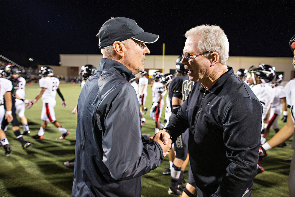 BENTONVILLE, AR, September 20, 2013:  Bentonville High School Tigers football game vs Euless Trinity, TX<br /> <br /> Head Coach Barry Lunney<br /> Defensive Line Coach Tony Cherico<br /> Wide Receivers Coach Rod Washington