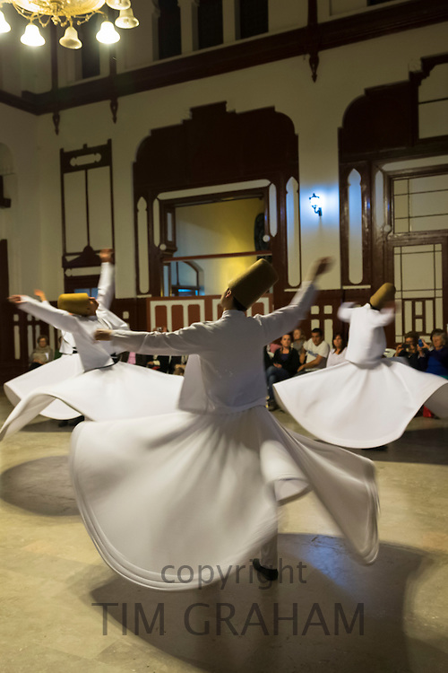 Whirling Dervish dance performance - Mevlevi Sema - spiritual ceremony (whirling dervishes) in Istanbul, Republic of Turkey