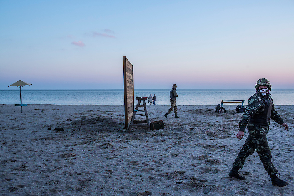 MARIUPOL, UKRAINE - FEBRUARY 4, 2015: New recruits of the St. Mary's Battalion undergo training on the beach at their base on the Sea of Azov in Mariupol, Ukraine. The pro-Ukraine battalion is one of a few tasked with defending the port city, which was hit late last month by an artillery barrage that killed at least 30 people, from pro-Russia rebels. CREDIT: Brendan Hoffman for The New York Times
