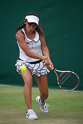 LONDON, ENGLAND - Monday, June 27, 2011: Miyu Kato (JPN) in action during the Girls' Singles 1st Round match on day seven of the Wimbledon Lawn Tennis Championships at the All England Lawn Tennis and Croquet Club. (Pic by David Rawcliffe/Propaganda)