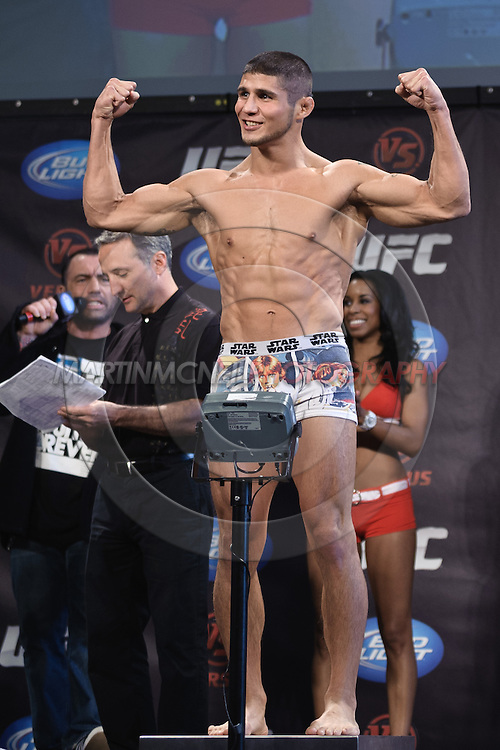 "PITTSBURGH, PENNSYLVANiA, JUNE 25, 2011: Joe Stevenson poses on the scales during the official weigh-in for ""UFC on Versus 4: Kongo vs. Barry"" inside Heinz Field Cocz Cola Great Hall in Pittsburgh, Pennsylvania on June 25, 2011."