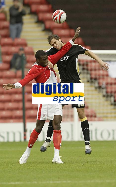 Photo: Aidan Ellis.<br /> Barnsley v Cardiff City. Coca Cola Championship. 29/09/2007.<br /> Barnsley's Kayode Odejayi challenges Cardiff's Roger Johnson