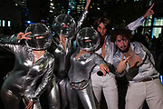 New York, NY - 31 October 2019. the annual Greenwich Village Halloween Parade along Manhattan's 6th Avenue. Women costumes as spacewomen, with disco-ball heads and silver lame jumpsuits.