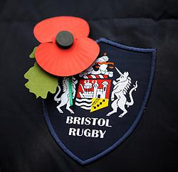 Bristol rugby logo and poppy - Photo mandatory by-line: Dougie Allward/JMP - Mobile: 07966 386802 - 11/11/2014 - SPORT - Bristol - Memorial Stadium - Remembrance Service