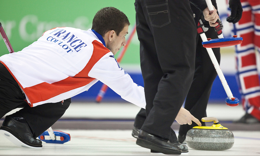 during a tie breaker in the Ford World Men's Curling Championships at the Brandt Centre in Regina, Saskatchewan, April 8, 2011.<br /> AFP PHOTO/Geoff Robins