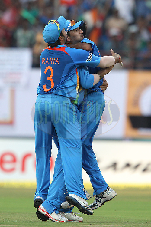Bhuvneshwar Kumar of India celebrates the wicket of Eoin Morgan of England with Suresh Raina of India and Yuvraj Singh of India during the 2nd Airtel ODI Match between India and England held at the Jawaharlal Nehru International stadium, Kochi, India on the 15th January 2013..Photo by Ron Gaunt/BCCI/SPORTZPICS ..Use of this image is subject to the terms and conditions as outlined by the BCCI. These terms can be found by following this link:..http://www.sportzpics.co.za/image/I0000SoRagM2cIEc