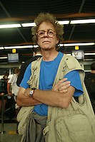 portrait of owen franken in a shooting vest in an airport
