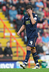 BRISTOL, ENGLAND - Saturday, August 7, 2010: Millwall's Darren Carter looks dejected as he walks off the field after being shown the red card and sent off during the League Championship match against Bristol City at Ashton Gate. (Pic by: David Rawcliffe/Propaganda)