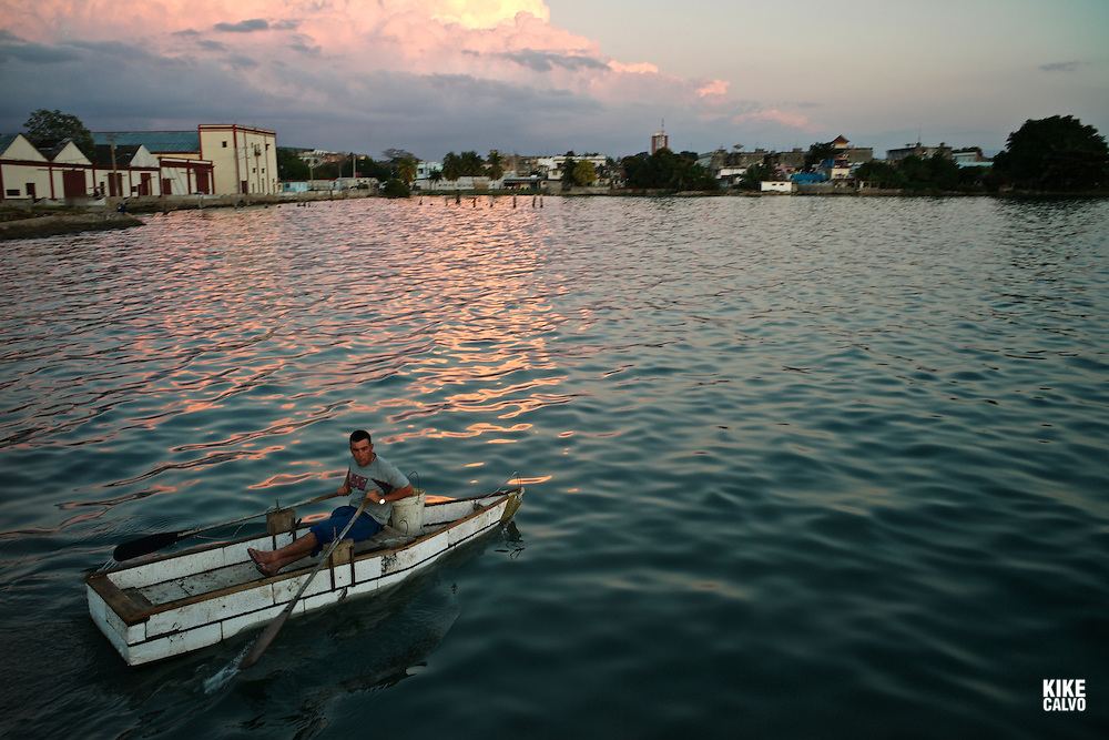 Cuban rowing at sunset. The maritime town of Cienfuegos has one of the most captivating bays in the Caribbean Sea